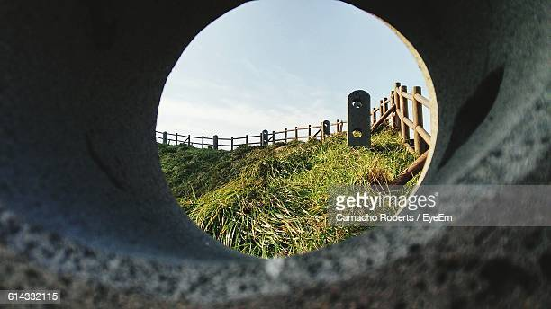 Wooden Fence On Grassy Field Seen Through Hole