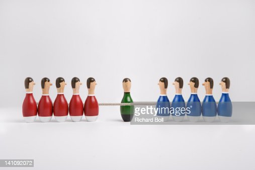 Wooden figures having a tug-of-war. : Stock Photo