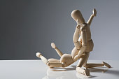 two wooden artist models in a sexual position