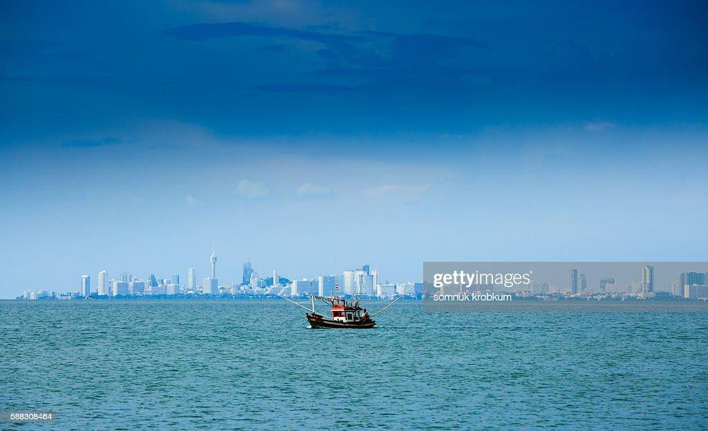 Wooden fishing boat in Pattaya bay.