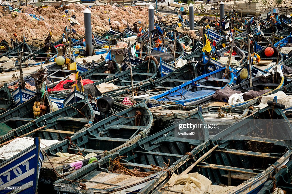 Wooden fishing boats lined up in Agadir harbour