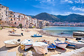 Wooden fishing boats on the old beach of Cefalu, Sicily, Italy.