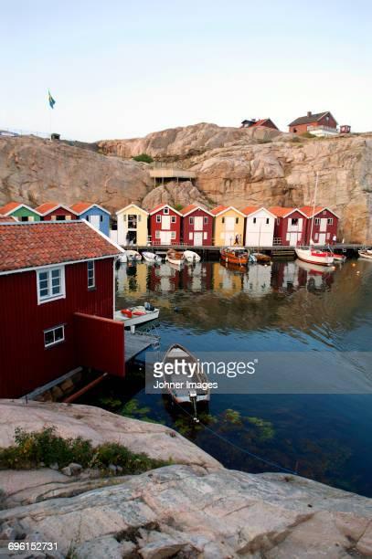 Wooden fishing huts on rocky coast