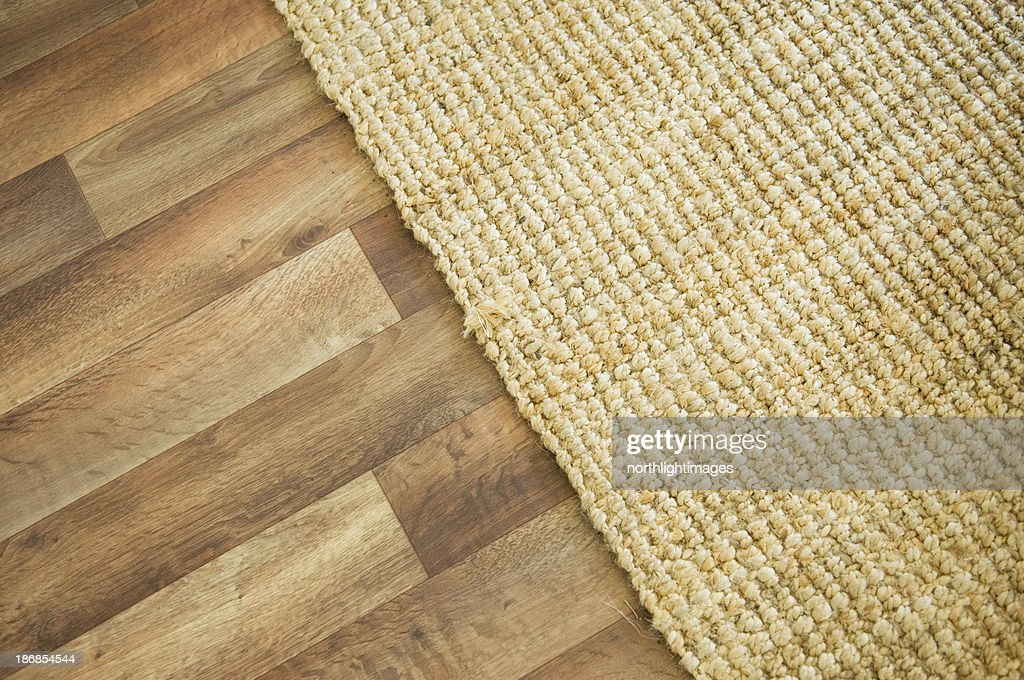 Wooden floor and rug : Stock Photo