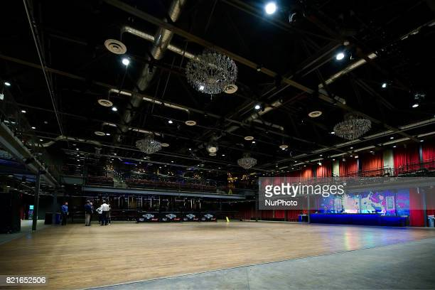 Wooden floor red fabric and chandeliers are style elements from the original 1954 Fillmore venue in the San Fransisco Bay Area that came back in the...