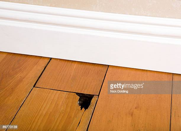 Wooden floor with hole in