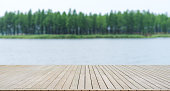Wooden footbridge beside river