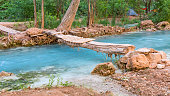 A wooden footbridge crosses Havasu Creek in the campground on the Havasupai Indian Reservation in the Grand Canyon.