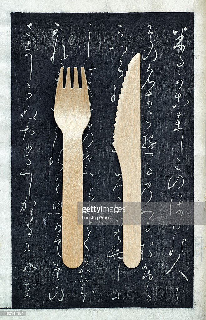 Wooden fork and knife on chalkboard