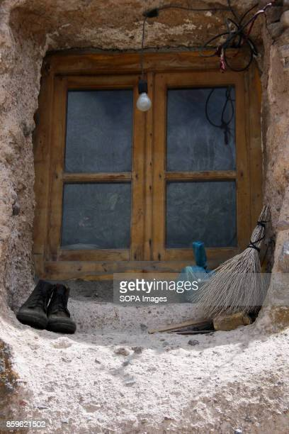 A wooden frame window is seen inside the rock The tiny village of Kandovan in the Iranian East Azerbaijan Province is known for its cliff dwellings...