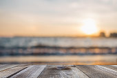 Wooden free space on table and sunset over the sea