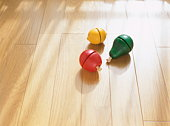 Wooden fruits on floor