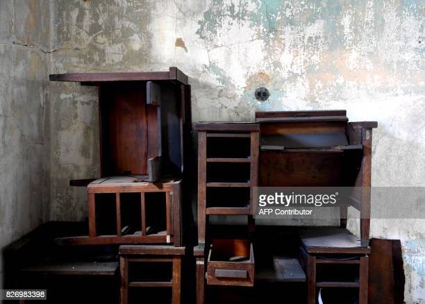 Wooden furniture is piled inside one of the buildings of the The Ellis Island Hospital on August 5 a 750bed facility which treated over 12 million...