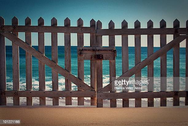 Wooden gate with sea