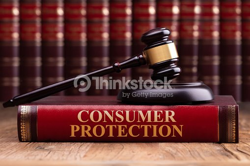 Wooden Gavel And Soundboard On Consumer Protection Law Book : Stock Photo