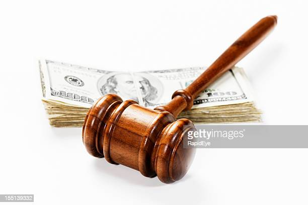 Wooden gavel and US dollars: bribery, a fine or payment