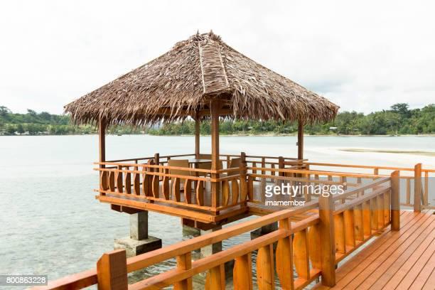 Wooden gazebo over the water, Erakor island, copy space