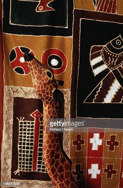 Wooden giraffe and printed textile at Mantenga Craft Centre