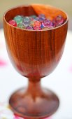 Wooden glass with jelly balls.