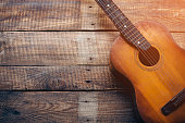 Close-up of guitar lying on vintage wood background