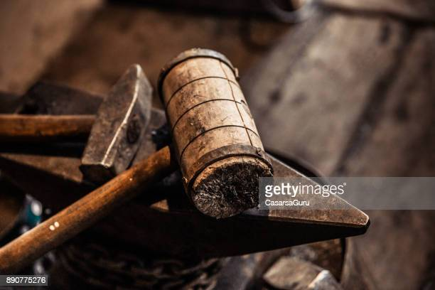 Wooden Hammer Placed on Anvil