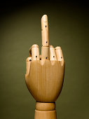 Wooden hand with middle finger extended