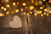 Wooden heart with Bokeh background and copyspace