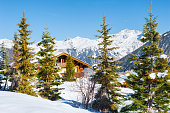 Wooden house in the Alps mountains, winter landscape. Courchevel, France