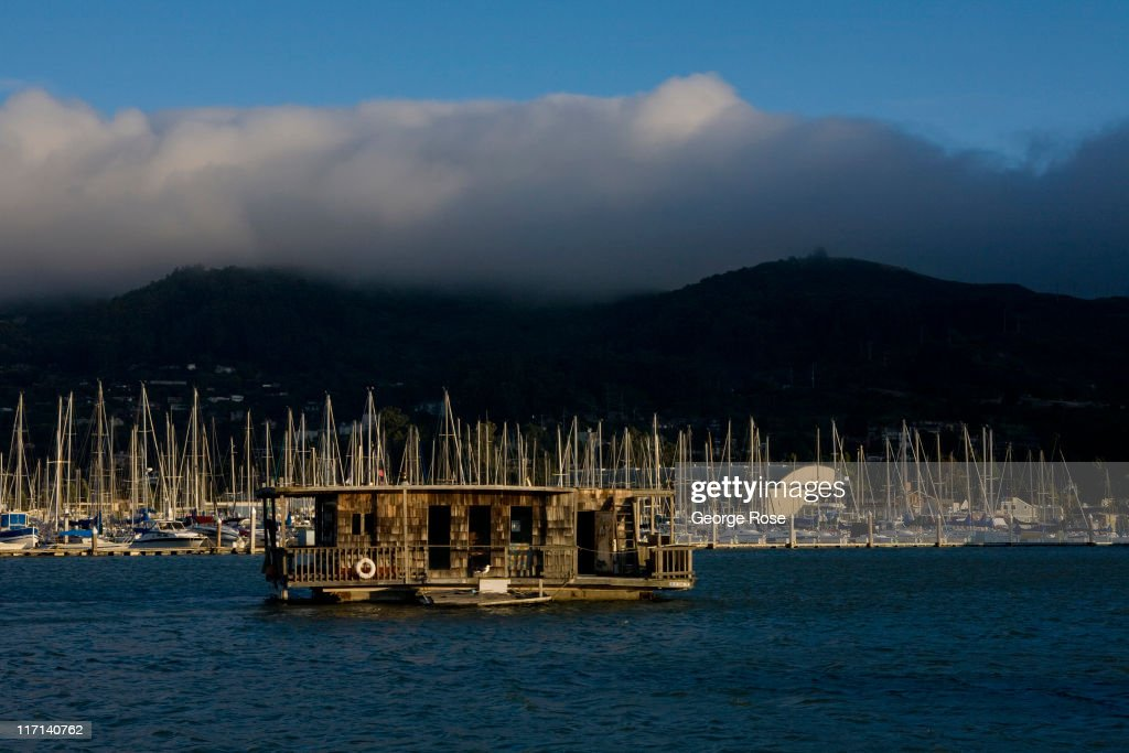 A wooden houseboat is anchored outside the Sausalito Marina on June 11, 2011 in Sausalito, California. The San Francisco Bay is home to thousands of sailing enthusiasts and will be the site of the 2013 America's Cup.