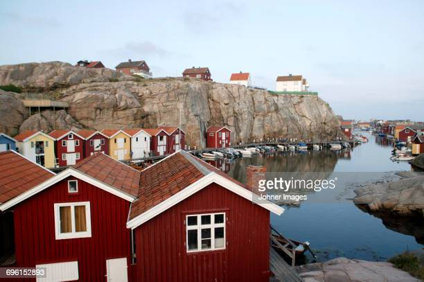 Wooden houses and fishing huts on rocky coast