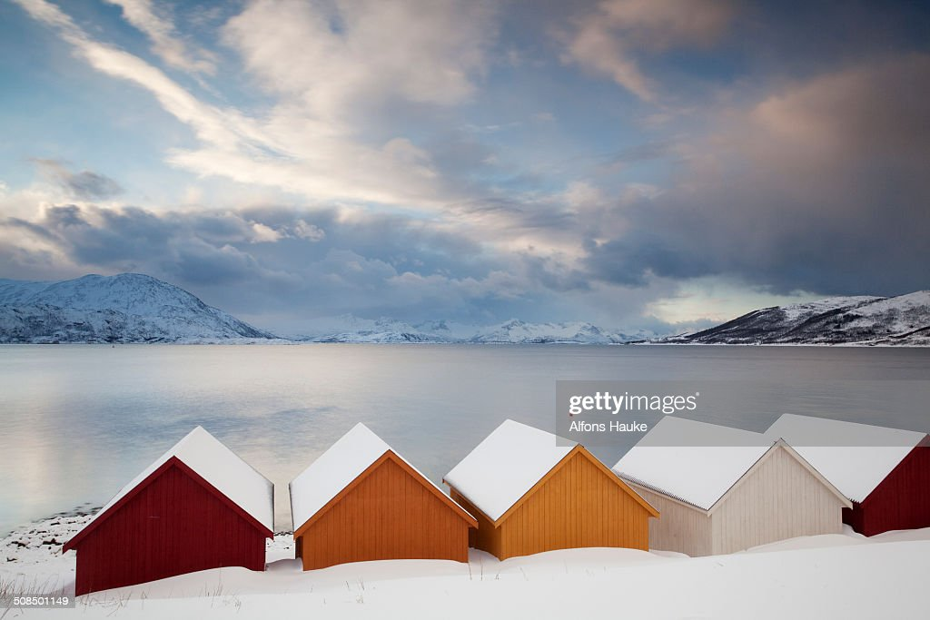 Wooden huts on the Nordfjord, Tromso or Tromso, Norway, Europe