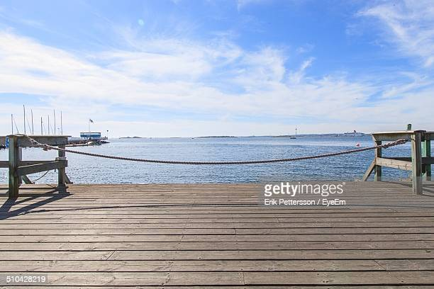 Wooden jetty against calm blue sea