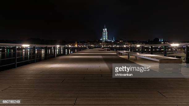 Wooden Jetty and cityscape at night, Deventer, Overijssel, Holland