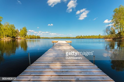 Wooden jetty on a sunny day in Sweden : Stock Photo