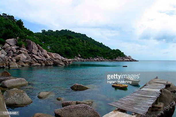 A wooden jetty on the coast of Koh Tao, tranquil, tranquility, tropical, paradise, pristine, tropical, heaven, delight, joy, haven, retreat, sanctuary, oasis, Thailand.