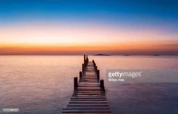 Wooden jetty on Yellow Sea at sunset, China