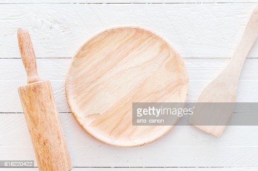 Wooden kitchen utensils on white  kitchen table : Stock-Foto