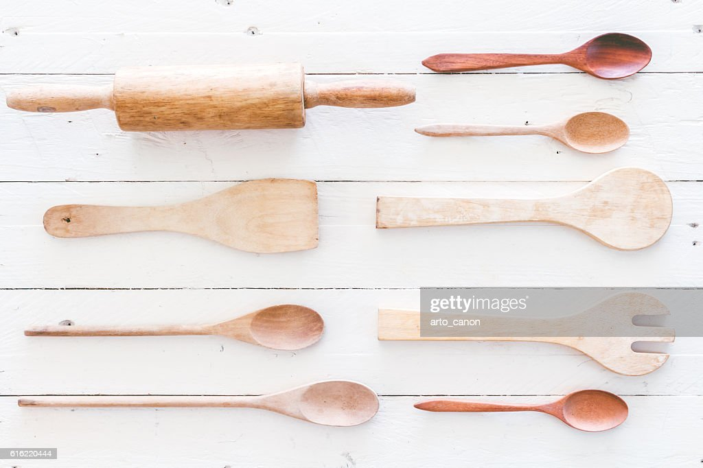 Wooden kitchen utensils on white  wooden background : Bildbanksbilder