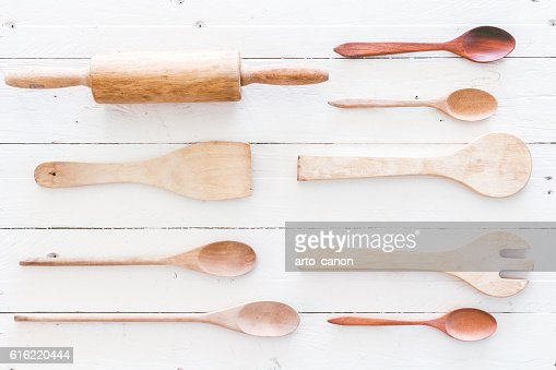 Wooden kitchen utensils on white  wooden background : Stock Photo
