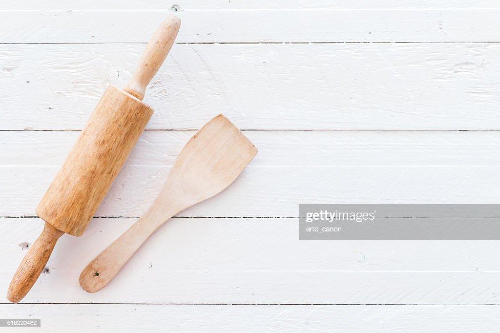 Wooden kitchen utensils on white  wooden background : Stock Photo