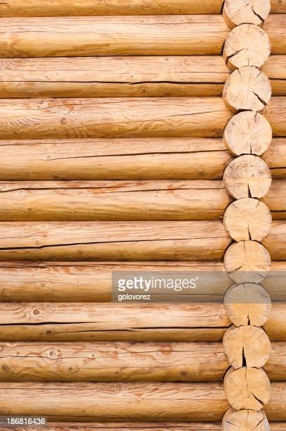 Wooden logs stacked to make a wall