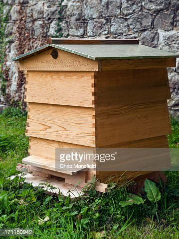 Wooden man made bee hive with multiple levels