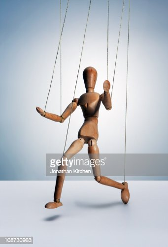 Wooden man on strings