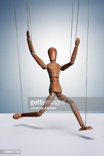 Wooden man with strings