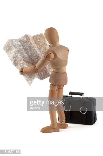 wooden mannequin searching the way in map