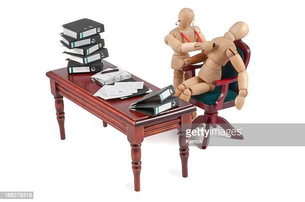 mannequin en bois avec des problèmes de santé au travail