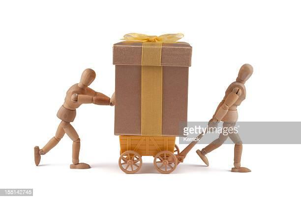 Wooden mannequins delivering a gift