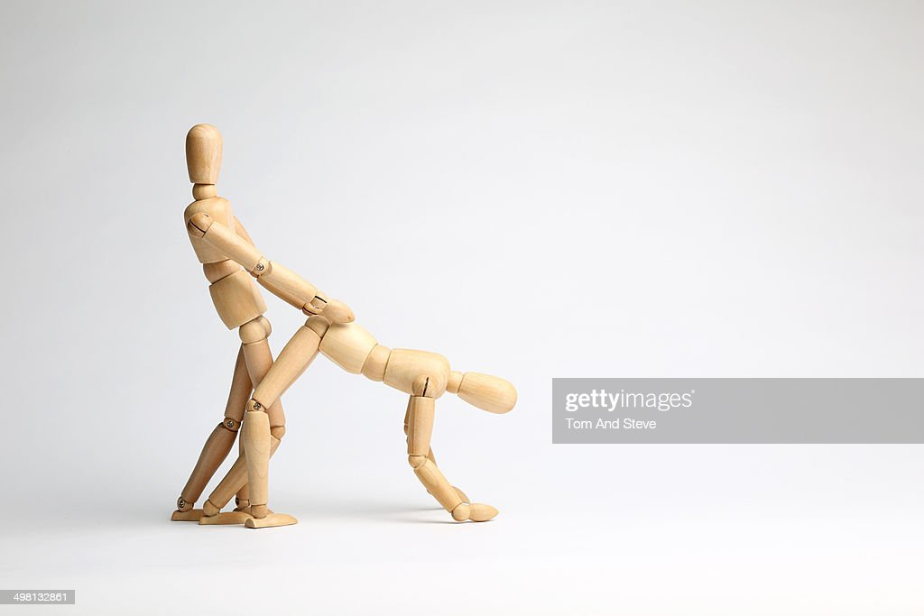 Wooden mannequins doggy style