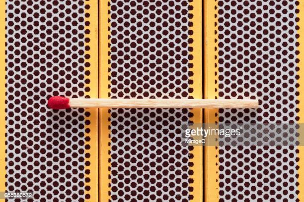 Wooden Matchstick on Matchbox