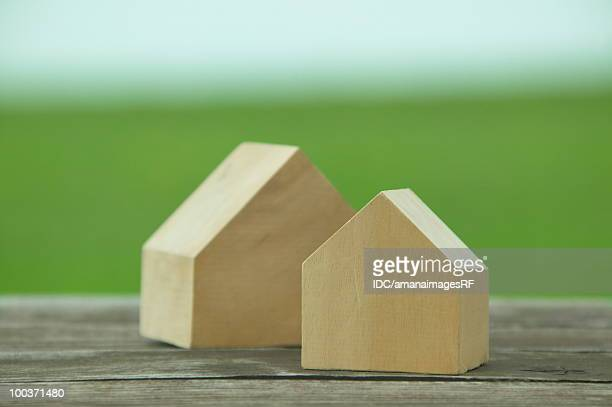 Wooden model houses in the field, differential focus